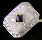 Elegantly engraved sapphire and diamond cufflinks. (J9039)
