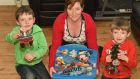 Donna Gray with her children, Alex aged 7 and Jake aged 4. The boys are pictured with their Share Box, one of the many tips Donna picked up at the Parenting Plus course in Ballybay creche, in Co Monaghan. Photograph: Philip Fitzpatrick