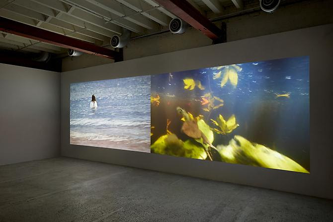 The Ghost in Between , 2013. Two channel video installation. Dimensions variable. 10:11 minutes with sound. Edition of 5.  Installation at Tierney Gardarin Gallery, NY. (c) John Muggenborg.