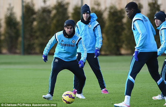 Diego Costa, training with Chelsea on Thursday, contested his FA charge for stamping on Emre Can