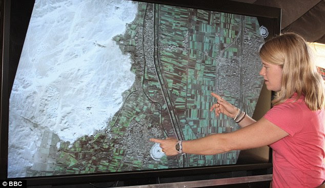 Only the beginning: Archaeologist Dr Sarah Parcak points out the site of a buried pyramid on a satellite image