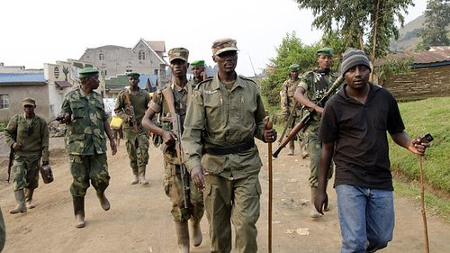 Col. Sultani Makenga of M23 with stick in middle of photograph. The M23 are defectors from the Democratic Republic of Congo army. They have seized several towns in the East. by Pan-African News Wire File Photos