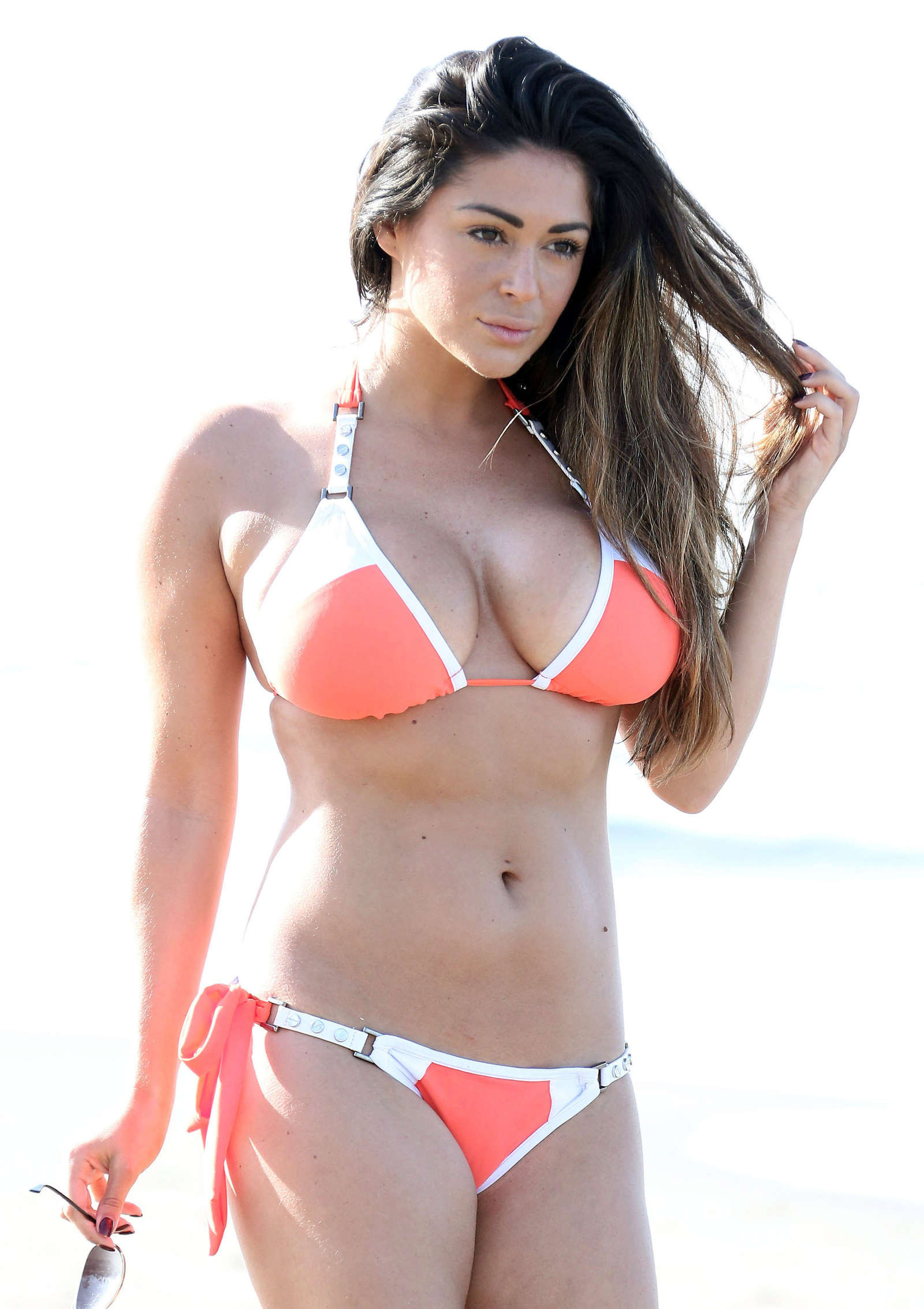 Casey Batchelor in Orange Bikini in Marbella