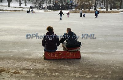 keep off sign on the frozen pond