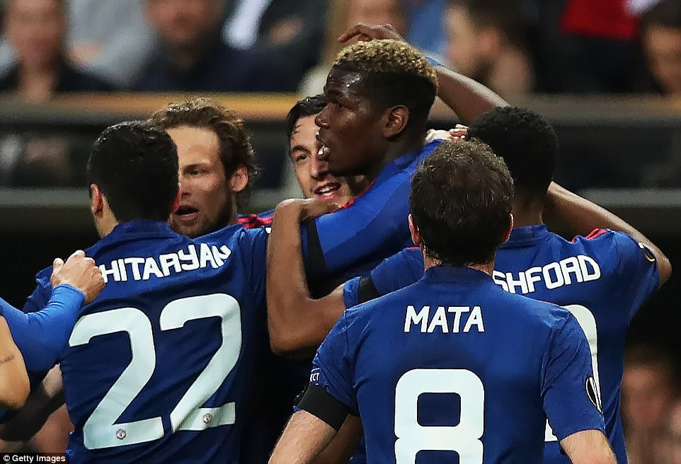 France international Pogba is mobbed by his delighted team-mates after giving them the lead in their European final