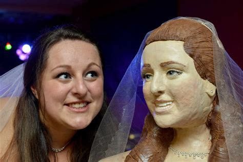 Bride bakes life size wedding cake of her and her groom