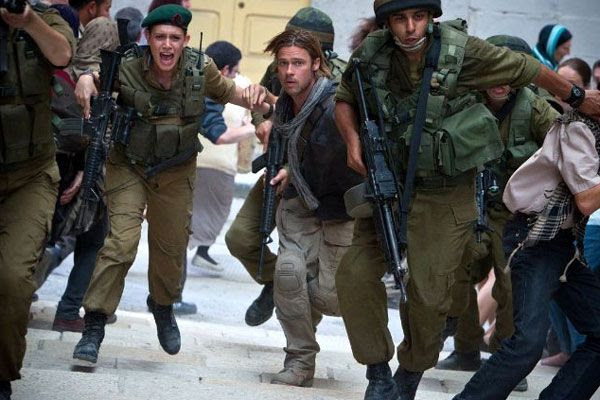 Surrounded by Israeli soldiers, Gerry Lane (Brad Pitt) takes on zombies invading Jerusalem in WORLD WAR Z.