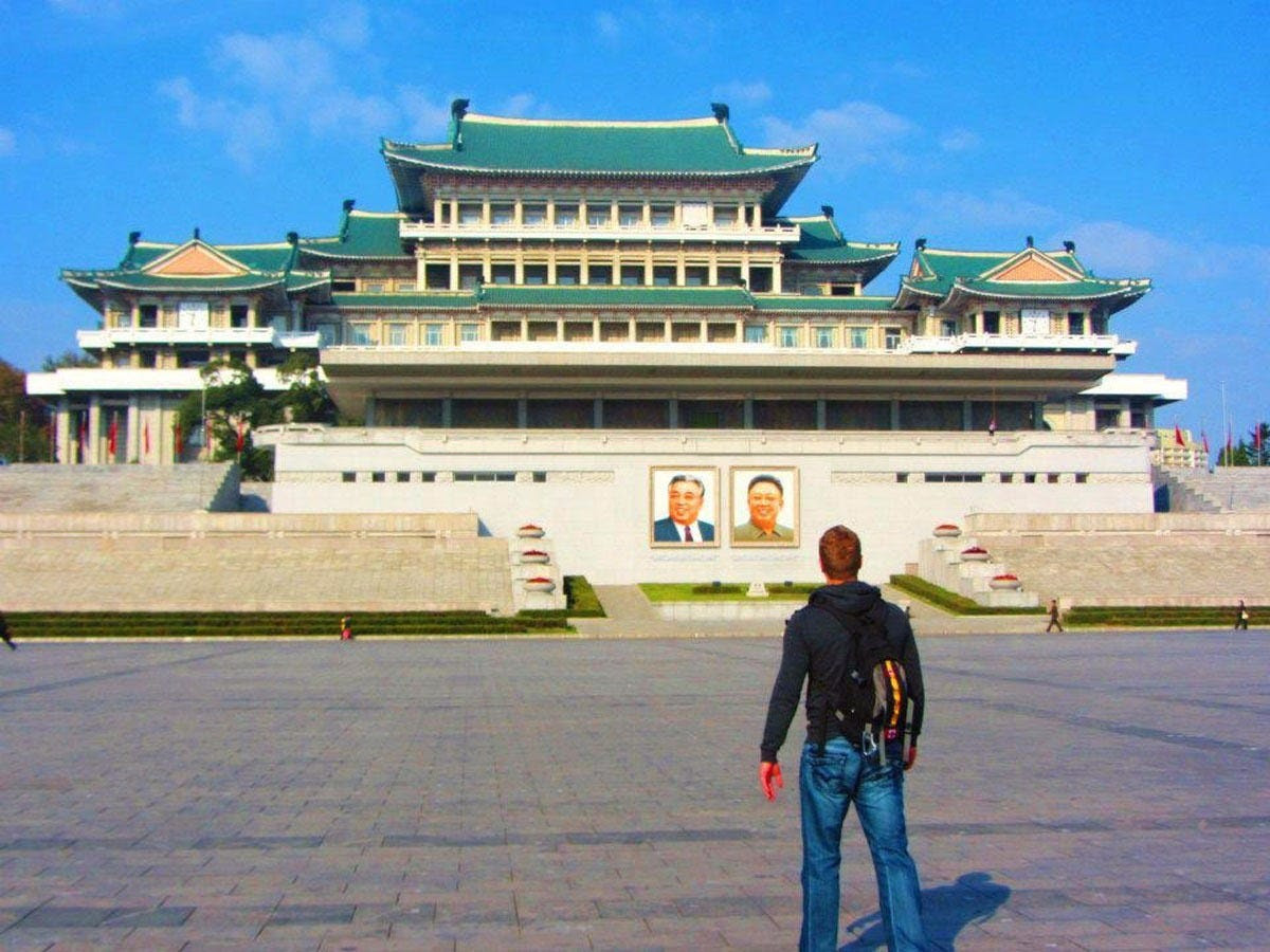 """For Justin, the major highlight was visiting the Grand People's Study House. Inside, there are over 30 million books, most of which feature the Great Leader and the Dear Leader. The green doors at the entrance are where Kim Jong Il and Kim Jong Un have conducted and watched over several military parades. """"It was surreal to be there and to be taken back to all of the news clips you see about the country,"""" Justin said."""