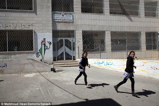 Girls play outside Dalal Mughrabi high school. In 1976 Mughrabi led an attack that left 37 people dead, 12 of them children