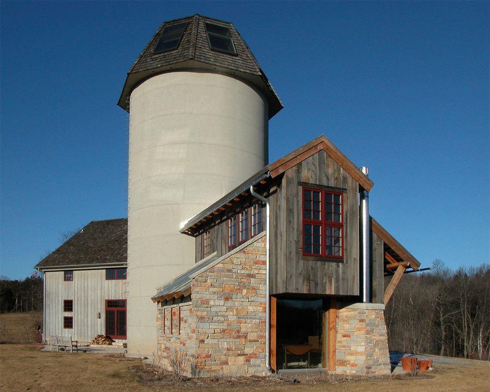 grain silo homes for a farmhouse exterior with a stone facade and barnhouse addition by gmk architecture inc