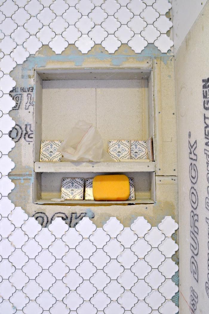 during-a-bathroom-bath-remodel-renovation-built-in-tiled-shower-shelves