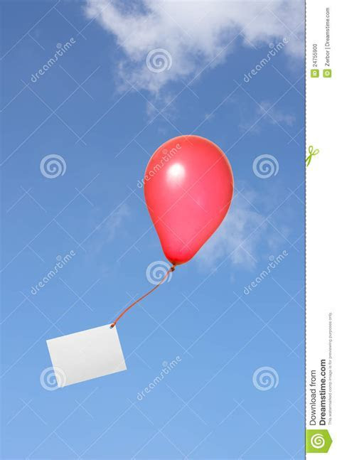 Red Balloon With Greeting Card In The Sky Stock Photo