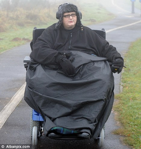 Increased mobility: Paul Mason now uses a motorised wheelchair to get around after surgery helped him shed 20 stone