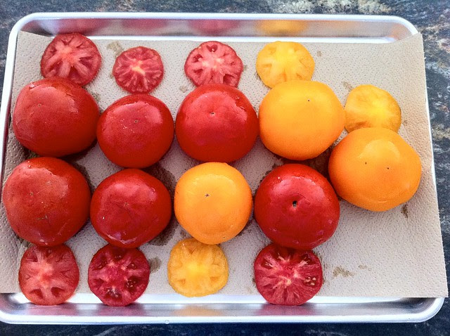 Tomatoes Draining on Lined Baking Sheet
