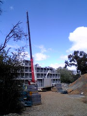 Containerised apartment module ready to be lifted into position at ANU