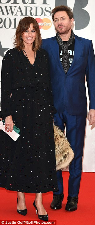 Mixture of musical styles: Stars of the music world including Florence Welch (left), Duran Duran's Simon Le Bon - joined by his wife Amber (centre) - and Lana Del Rey (right) were also out in force