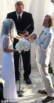 Third time lucky as Milla Jovovich weds director Paul