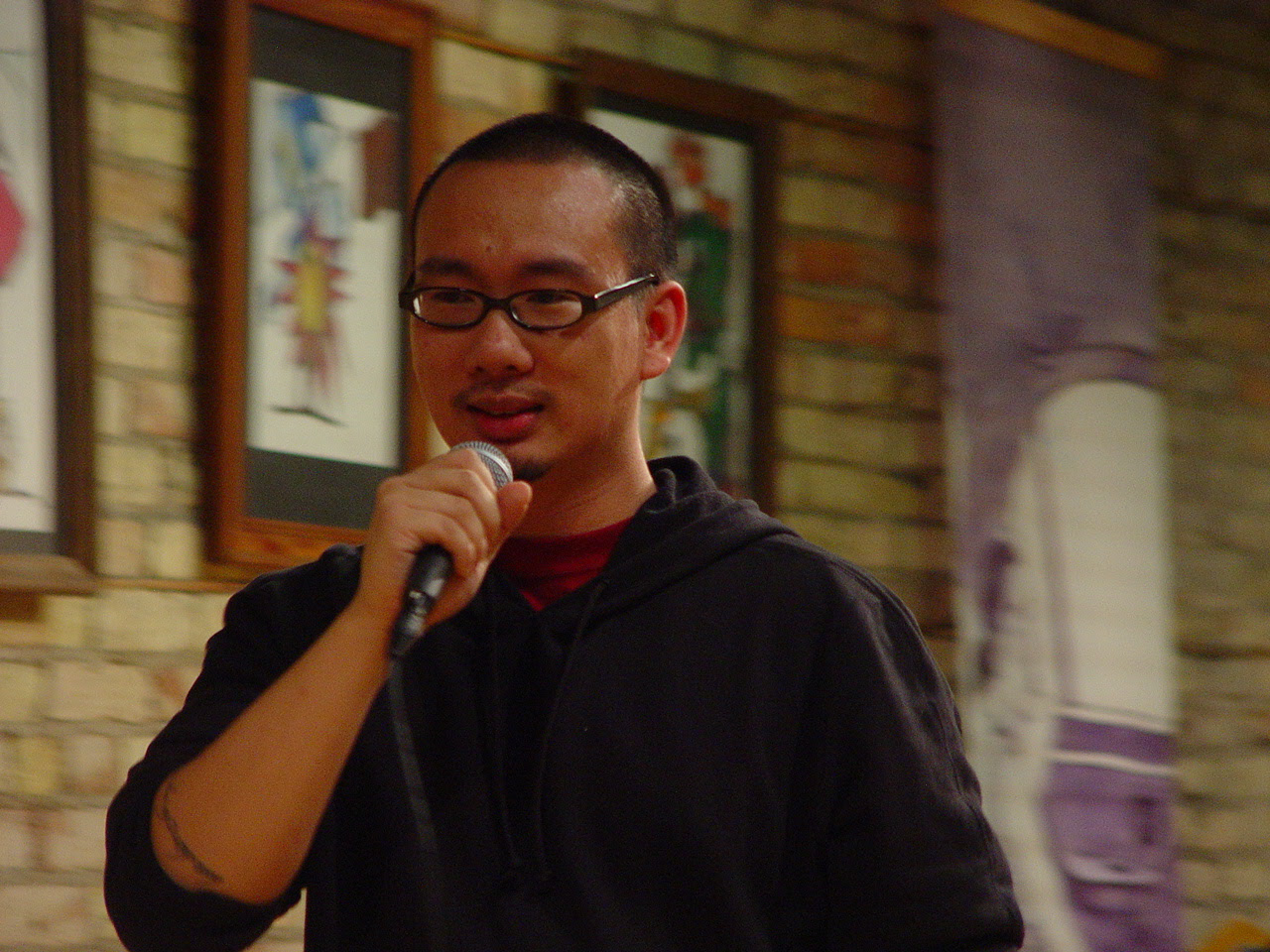 Bao Phi in 2005 reading at the debut of Real Karaoke People by Ed Bok Lee
