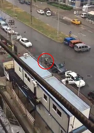 Further footage then shows what appears to be a second officer (circled) being shot by an attacker