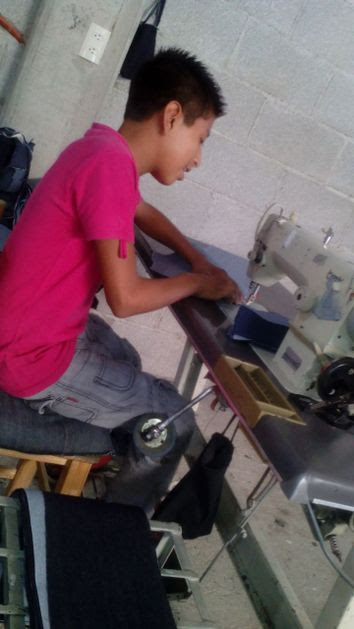 A boy works in a maquiladora textile plant in the state of Puebla, in central Mexico. Credit: Courtesy of Joaquín Cortez
