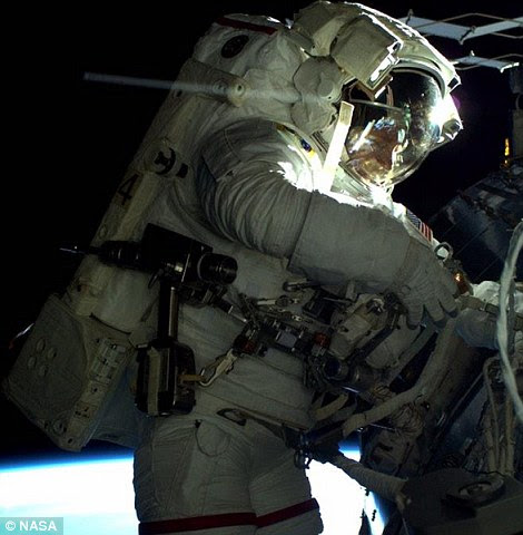 Terry Virts (right) is seen during the third spacewalk outside the International Space Station Sunday during the six hour, 45 minute outing, in which he helped set up antennas and communications equipment. The left image shows Butch Wilmore fixing cables