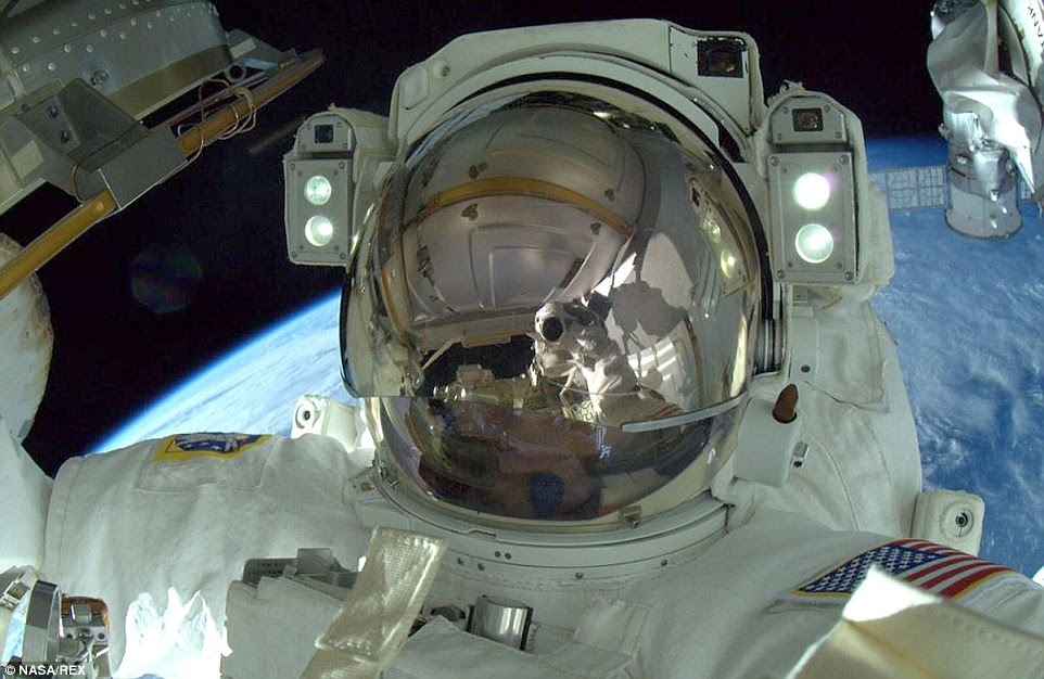 Terry Virts took a space selfie, moments after completing the job. He wrote on Twitter: 'Mission Accomplished - three #spacewalks, 800' of cable, four antennas, three laser reflectors, one greased robotic arm'