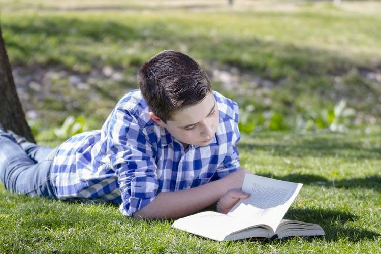 Young-boy-reading-900