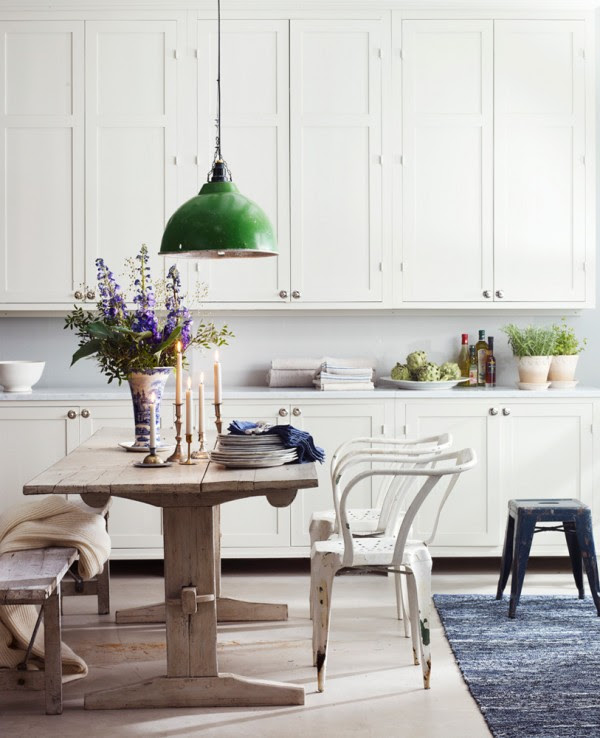 White Kitchen with Green Industrial Pendant Light and Rustic Wood Dining Table