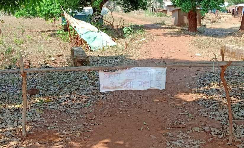 A village in Bastar self-quarantines by putting a fence at the entry. A hand written note warns outsiders against entering the village. Image procured by Debobrat Ghose/Firstpost