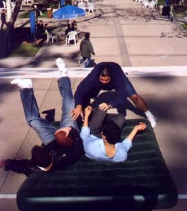 Chris and Mike falling onto a stunt mat (actually an inflatable bed used for camping) after being tackled by Tommy.