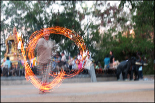 Sunset fire dancer at Cape Phromthep