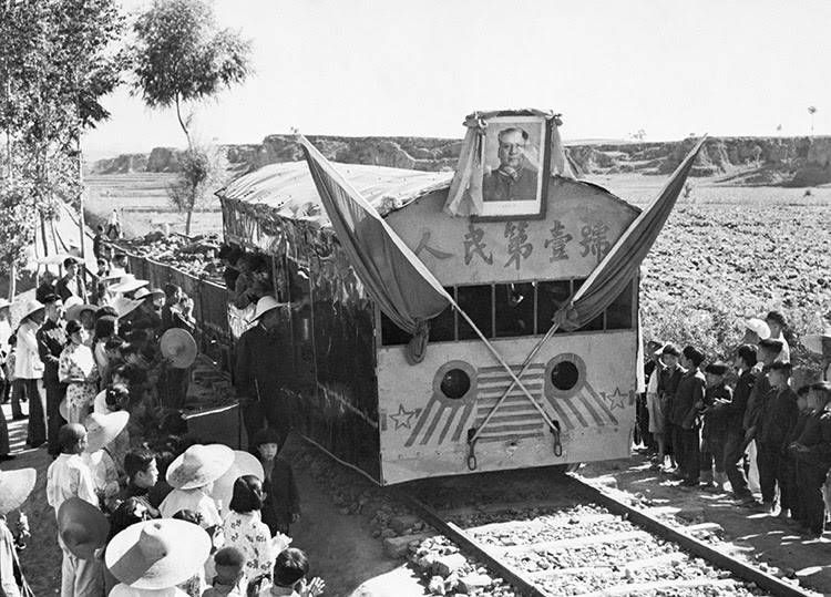 Blood on the tracks: a portrait of Mao adorns a freight train in Yuhsien County, Shansi Province, May 5th, 1958.