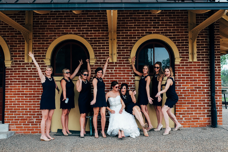 Family formal portraits, bridal party, and couple's portrait session at St. Mary's Church, downtown Galena on the Riverfront, and Eagle Ridge Resort. Wedding photographer; Ryan Davis Photography – Rockford, Illinois.