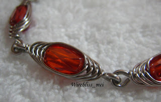 Close up of Wire Wrapped HBW crystal bead