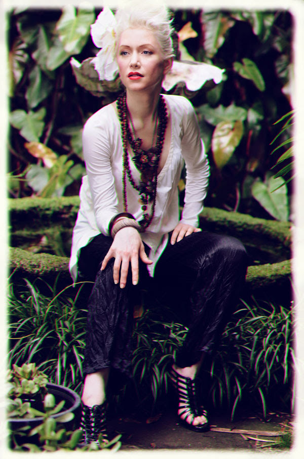 White top, black slacks, seated at a fish pond, Fashion Catalogue
