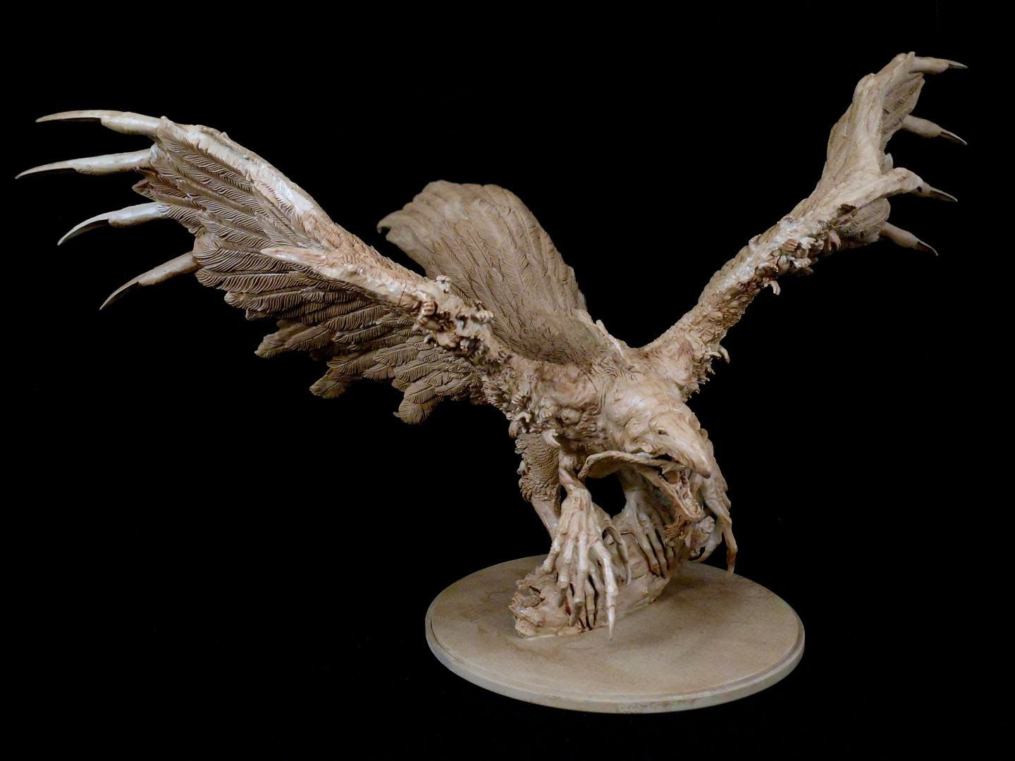 The phoenix from Kingdom Death: Monster, washed with soft tone to shade and bring out detail.