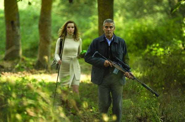 Thekla Reuten and George Clooney play assassins in THE AMERICAN.