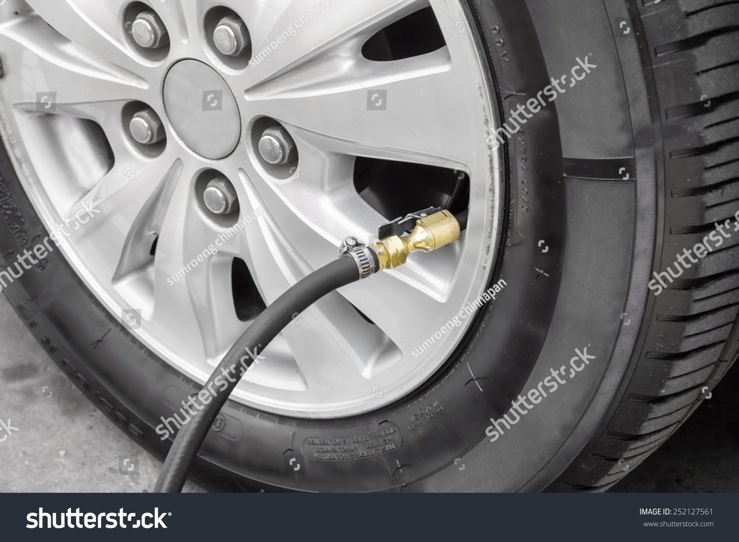 Filling Air Into A Car Tire Stock Photo 252127561