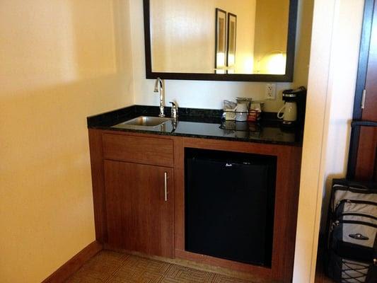 Wet bar with mini refrigerator. | Yelp
