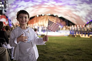 A young patriot salutes heroes at the 2009 Nat...