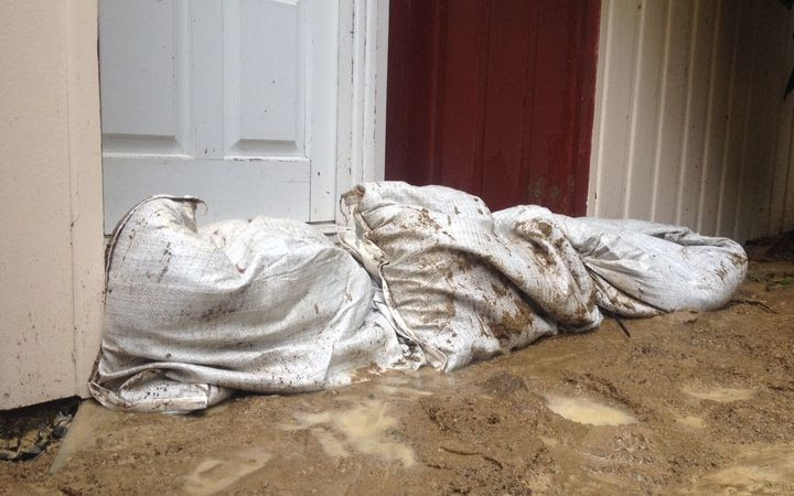 Sandbags were being used at houses in Kaiwharawhara (pictured) and Mornington in Wellington.