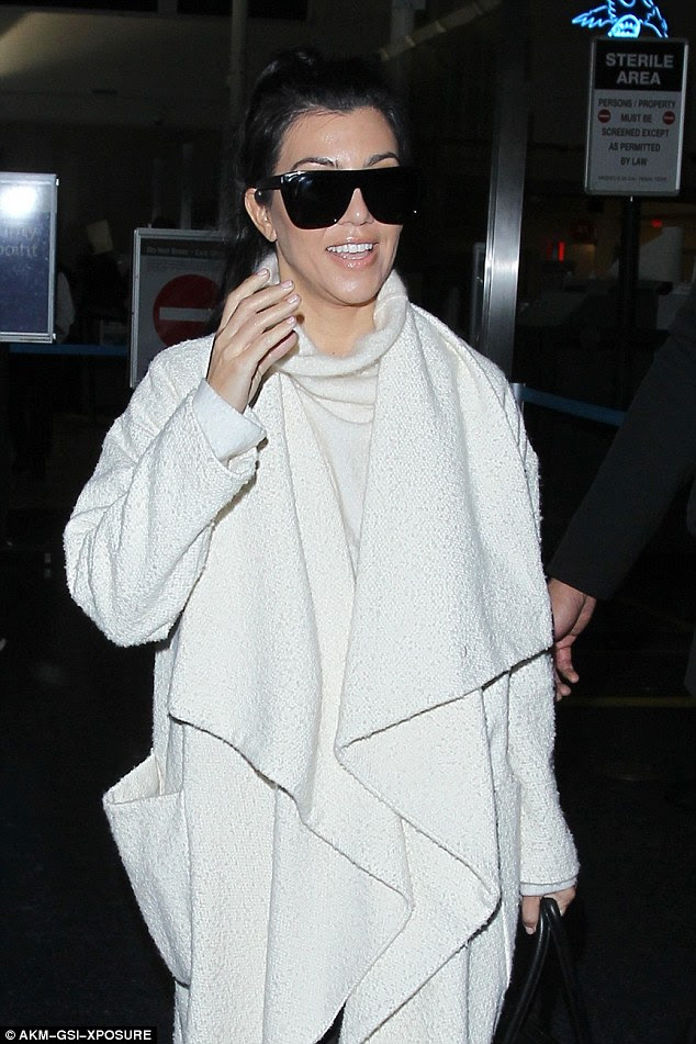 Shady lady: Kourtney designer black glasses stayed in place as she made her way to her ride