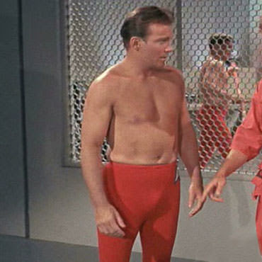 Although I know there is a clip of Denny Crane wearing shirt, coat, tie and boxers (and presumably black shoes and sox), I can't find it, so you'll just have to settle for Shatner topless.