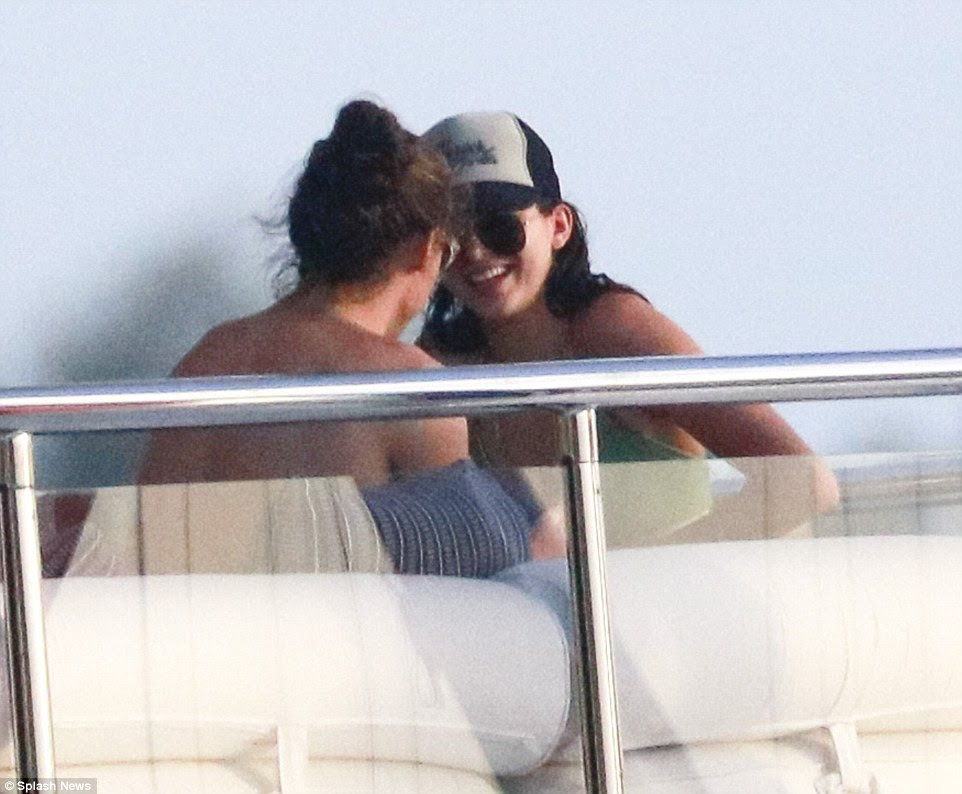 Back together? Harry Styles (left) and Kenndal Jenner (right) fuelled reconciliation rumours on Thursday after  pictures appeared to confirm that they were enjoying a romantic getaway in St Barts