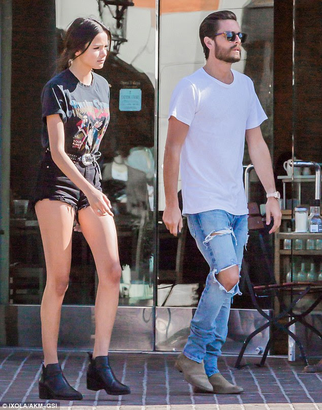 His new lady love: Scott Disick was seen with leggy model Christine Burke as they left Toscanova in Calabasas on Tuesday