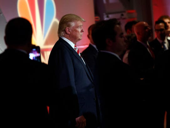 Donald Trump waits offstage to be introduced during