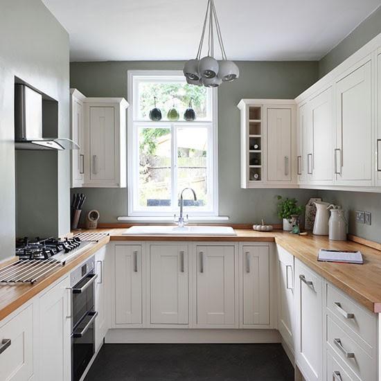 White and sage green kitchen | Kitchen storage ideas ...