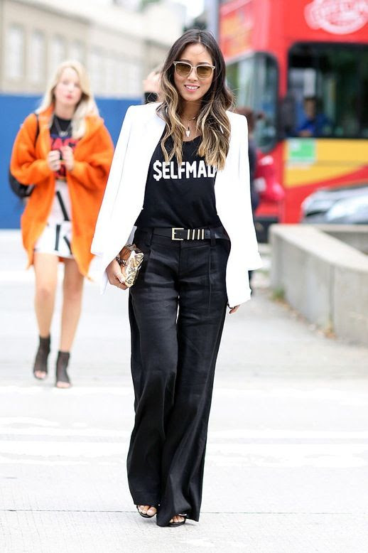 Le Fashion Blog Blogger Street Style Nyfw Beige Sunglasses Wavy Hair White Blazer Graphic Tee Metallic Clutch Metal Detailed Belt Black Wide Leg Pants Via Popsugar