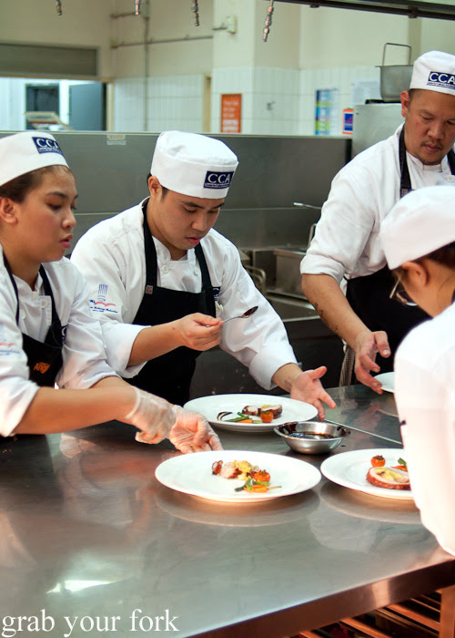 CCA Manila chefs plating up the pork belly at the Filipino Barbie