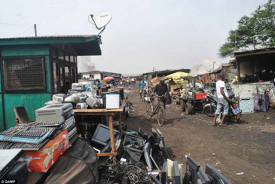 Profit: Locals in Ghana's capital Accra intercept trucks carrying the discarded products and buy the products without testing them - to later sell them in the city's market (pictured)